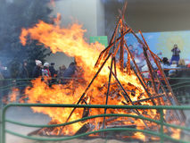 Fire of a burning scarecrow of the Shrovetide. Stock Photo