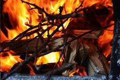 Fire burning to keep the heat in machine for making brandy Stock Photo