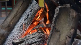 The fire of burning wood. Fire: burning wood and smoldering embers stock video footage