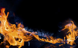 Fire. The fire, burning wood in the furnace, making charcoal for oral food Stock Image