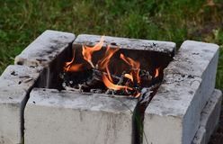 Fire burning wood in a hearth of brick stock photo