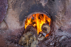 Fire burning wood in the oven Royalty Free Stock Image