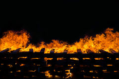 Fire burning wood pile Stock Images