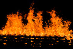 Fire burning wood pile Stock Photo