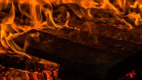 Fire. Burning wooden planks in fireplace Royalty Free Stock Photos