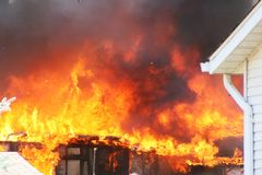 Fire burns down a house royalty free stock photo
