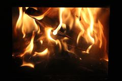 A fire burns in a fireplace. Burning logs in a fireplace. royalty free stock photo