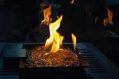 Fire burns in a fireplace with a close up royalty free stock photo