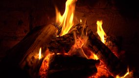 A fire burns in a fireplace, fire to keep warm stock footage