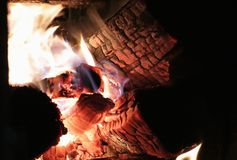 The fire burns in the fireplace stock image