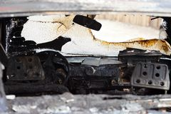 Fire burnt car vehicle. Wreck accident fire burnt wheel car vehicle junk Stock Images