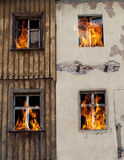 Fire bursts through two windows Royalty Free Stock Photography
