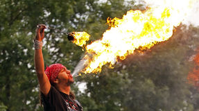 Fire busker juggle exhale flame royalty free stock photography