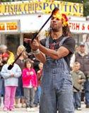 Fire busker juggle twirl stock photo