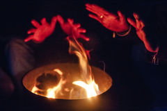 Fire camp with hands. feel so good in freezing cold weather in the night at Lachen in North Sikkim, India Stock Photos