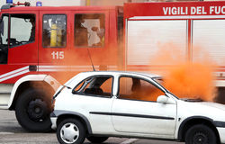 Fire on a car and engine intervention of firefighters. Principle of fire on a car and engine intervention of firefighters Stock Photo