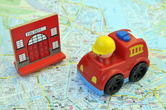 Fire car on the map of a city Royalty Free Stock Image