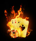 Fire cards. Old vintage cards and a gambling chip Stock Image