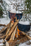 On the fire in the cauldrons melted snow. Stock Images