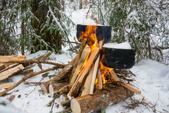 On the fire in the cauldrons melted snow. Royalty Free Stock Photos