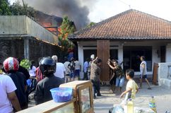 FIRE CAUSE. People are evacuating stuffs as fire rage a home industry in the middle of a dense housings at Sukoharjo, Java, Indonesia. Bad electrical Royalty Free Stock Images