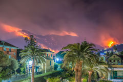 Fire caused by drought. Fire on the mountain of the port city of Genoa Nervi Royalty Free Stock Image