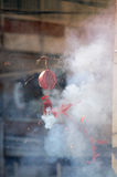 Fire caused by firecrackers at Chinese traditions and Customs. Stock Photos