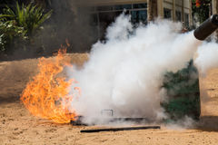 Fire caused by gas canisters by fire extinguish. Demonstration of fire caused by gas canisters by fire extinguishers stock photo