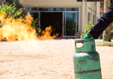 Fire caused by gas canisters by hand Royalty Free Stock Images