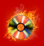 Fire cd. Burninging disk on colour background Royalty Free Stock Photos