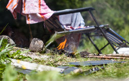 Fire on a chair on a background of nature on a picnic Royalty Free Stock Images
