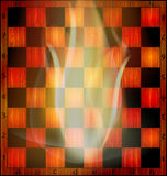 Fire and chessboard. Abstract empty wooden chessboard and fire inside Royalty Free Stock Images