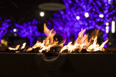 Fire and Christmas Lights Royalty Free Stock Photography