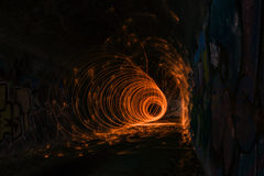 Fire circle in tunnel. Steel wool circle inside of tunnel Stock Photography