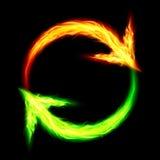 Fire circular arrows. Orange and green fire circular arrows on black background Stock Photos