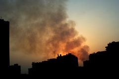 Fire in the city. Fire smoke inside the city royalty free stock photo