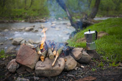 The fire in the clearing near the river. Stock Photography