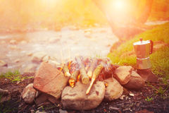 The fire in the clearing near the river. Royalty Free Stock Photography