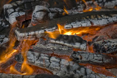 Fire close up. Middle of a wood fire with flames and glowing embers, close up Royalty Free Stock Photo