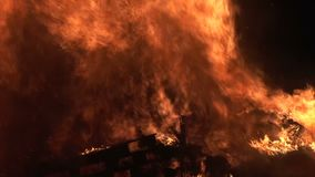 Close up of fire burning in black background. Fire close up of with flames rising