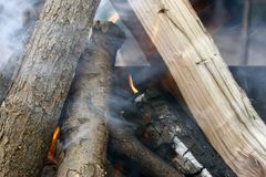 Fire. Closeup of pile of wood burning with flames in the fireplace. Burning tree Bonfire on the grill with smoke. Arson or natural disaster. Bonfire close. Fire royalty free stock photo
