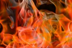 Yellow orange flames closeup background royalty free stock photos