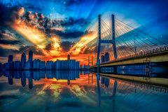 Fire cloud-Nanchang Bayi Bridge. The burning cloud refers to the red clouds that appear at sunrise or sunset, and is one of the phenomena of atmospheric change stock photo