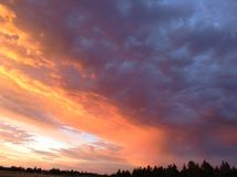 Fire clouds. Clouds that look like fire from the forest Royalty Free Stock Photography