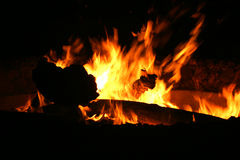 Fire. Coal logs warm flames soot hell hot carbon crackle camp burning Stock Image