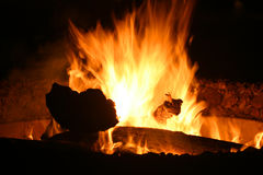 Fire. Coal logs warm flames soot hell hot carbon crackle camp burning Stock Photography