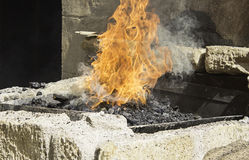 Fire on coals Royalty Free Stock Photo