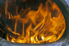Fire and coals close up in a chiminea Royalty Free Stock Photo