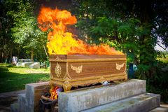 Fire on the coffin for cremation Royalty Free Stock Photography