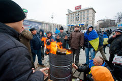 Fire on the cold main Maidan square with people oc Stock Photos